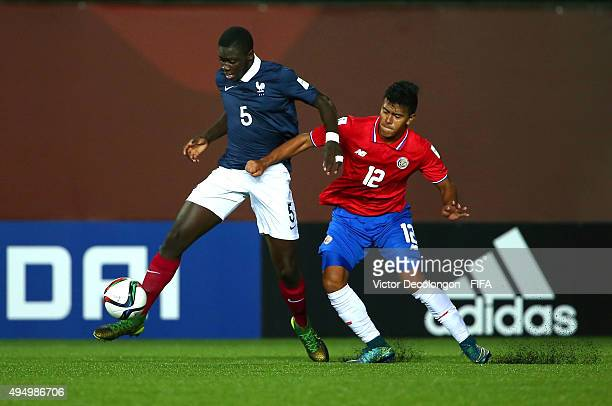 Dayotchanculle Upamecano of France and Sergio Ramirez of Costa Rica vie for the ball during the France v Costa Rica Round of 16 FIFA U17 World Cup...