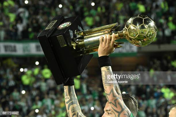 Dayro Moreno lifts the trophy to celebrate after winnig a match between Atletico Nacional and Chapecoense as part of CONMEBOL Recopa Sudamericana...