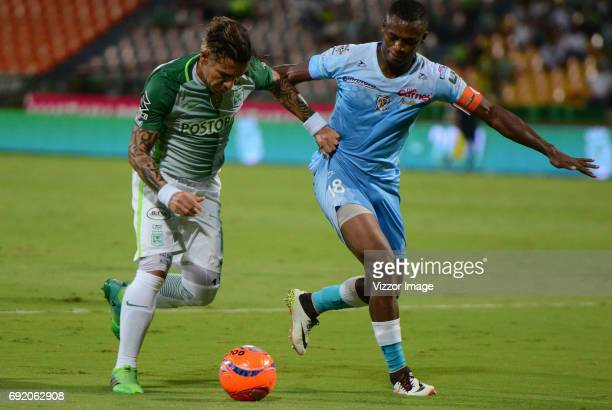 Dayro Moreno of Atletico Nacional fights for the ball with Wilmer Diaz of Jaguares FC during the match between Atletico Nacional and Jaguares FC as...