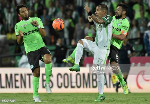 Dayro Moreno of Atletico Nacional fights for the balll with Abel Aguilar and Andres Perez of Deportivo Cali during the Final second leg match between...