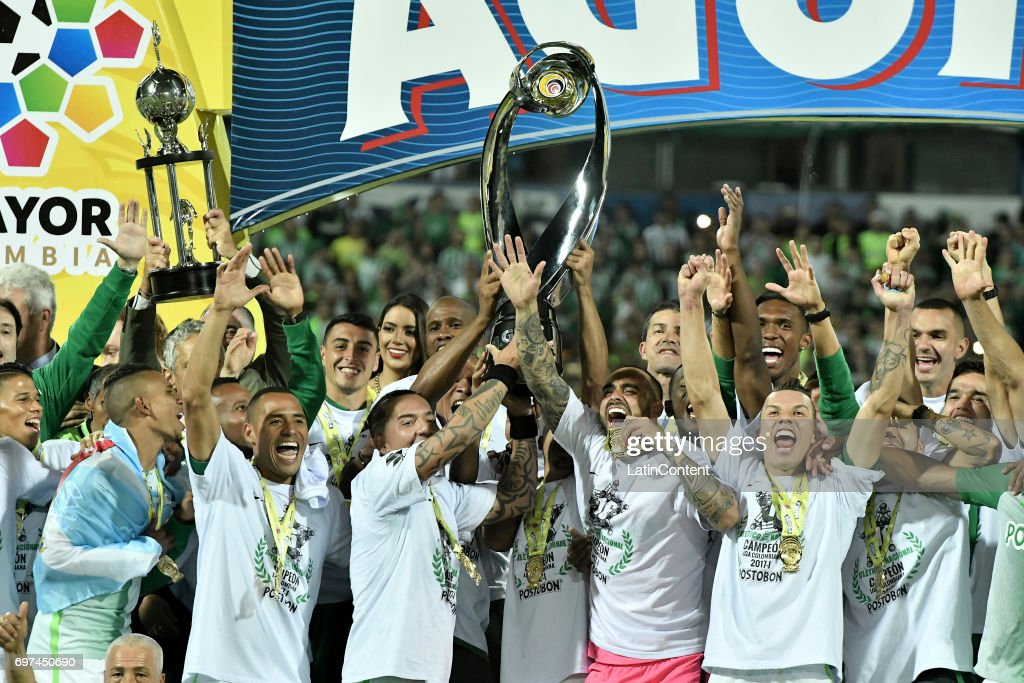 Dayro Moreno of Atletico Nacional lifts the trophy with teammates to celebrate after winning the Final second leg match between Atletico Nacional and Deportivo Cali as part of Liga Aguila I 2017 at Atanasio Girardot Stadium on June 18, 2017 in Medellin, Colombia.