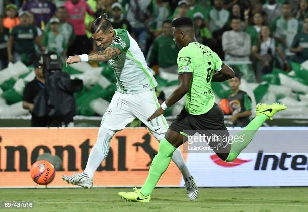 Dayro Moreno of Atletico Nacional vies for the ball with Danny Rosero of Deportivo Cali during the Final second leg match between Atletico Nacional...