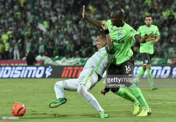 Dayro Moreno of Atletico Nacional vies for the ball with German Mera of Deportivo Cali during the Final second leg match between Atletico Nacional...
