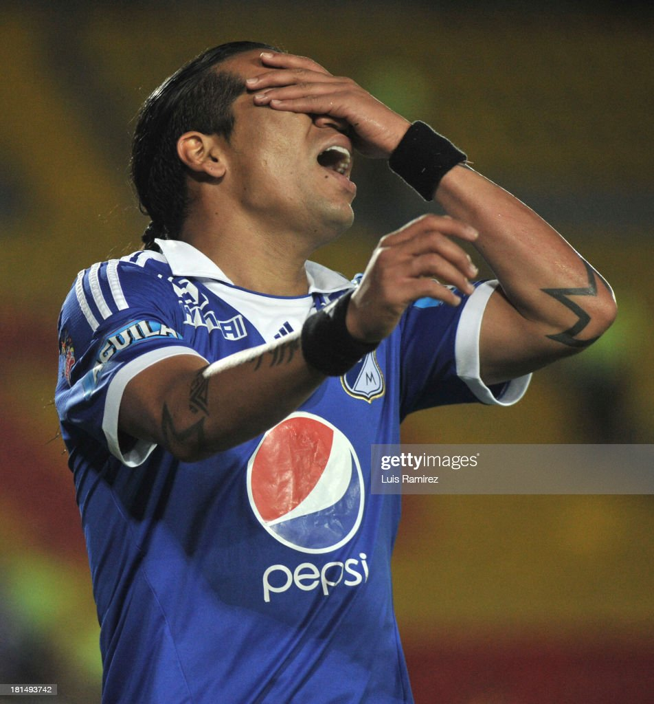 Dayro Moreno of Millonarios reacts after missing a goal during a match between Independiente Santa Fe and Millonarios as part of the Liga Postobon II at Nemesio Camacho Stadium on September 21, 2013 in Bogota, Colombia.