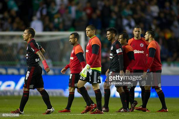 Dayro Moreno of Tijuana and teammates leave the field after losing the quarter finals first leg match between Leon and Tijuana as part of the Torneo...