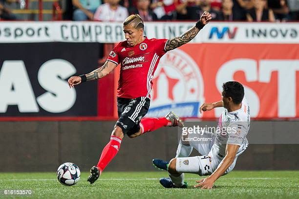 Dayro Moreno of Tijuana kicks the ball during the 14th round match between Tijuana and Chiapas as part of the Torneo Apertura 2016 Liga MX at...
