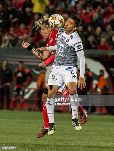 Dayro Moreno of Xolos and Efrain Velarde of Leon during the quarter finals second leg match between Tijuana and Leon as part of the Torneo Apertura...
