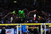 Dayron Robles of Cuba and Jason Richardson of the United States of America compete in the Mens 110m Hurdles during the Aviva London Grand Prix at...