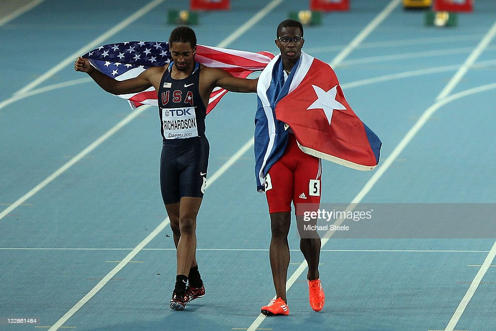 <a gi-track='captionPersonalityLinkClicked' href=/galleries/search?phrase=Dayron+Robles&family=editorial&specificpeople=812613 ng-click='$event.stopPropagation()'>Dayron Robles</a> (R) of Cuba and <a gi-track='captionPersonalityLinkClicked' href=/galleries/search?phrase=Jason+Richardson+-+Hurdler&family=editorial&specificpeople=15223987 ng-click='$event.stopPropagation()'>Jason Richardson</a> of United States celebrate after the men's 110 metres hurdles final during day three of the 13th IAAF World Athletics Championships at the Daegu Stadium on August 29, 2011 in Daegu, South Korea. Richardson was awarded the gold medal after <a gi-track='captionPersonalityLinkClicked' href=/galleries/search?phrase=Dayron+Robles&family=editorial&specificpeople=812613 ng-click='$event.stopPropagation()'>Dayron Robles</a> of Cuba was disqualified.
