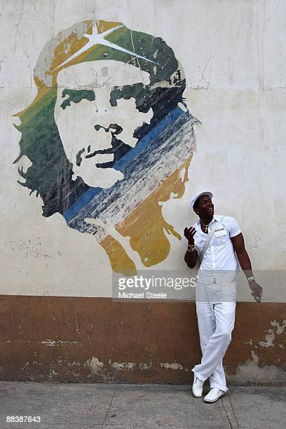 Dayron Robles of Cuba the Olympic champion and world record holder in the 110m hurdles poses for a portrait under a mural of Che Guevara in the old...