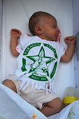 A 38 days old baby girl attends with the shirt of St Paolino the annual Festa dei Gigli on June 26 2016 in Nola Italy When St Paolini the bishop of...