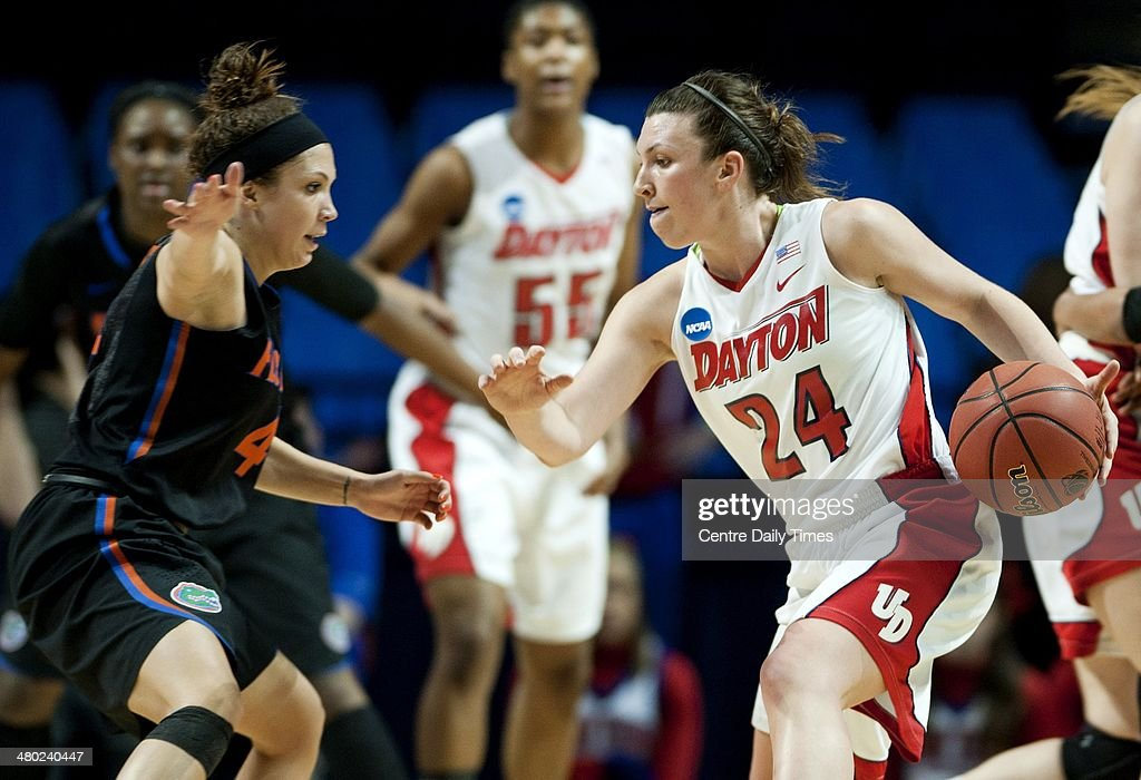 Dayton Flyers' Andrea Hoover dribbles around Florida Gators' Carlie Neelds during the first round of the women's NCAA Tournament on Sunday, March 23, 2014, at the Bryce Jordan Center in State College, Pa.