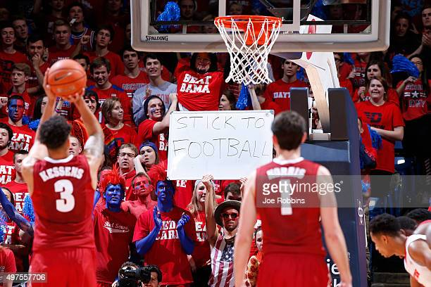 Dayton Flyers fan try to distract a free throw attempt by Michael Kessens of the Alabama Crimson Tide in the second half of a game at University of...