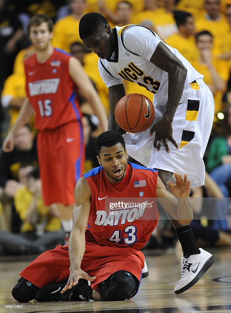 Dayton guard Vee Sanford (43) and Virginia Commonwealth University forward Jarred Guest (23) battle for a loose ball in the first half at the Stuart Siegel Center in Richmond, Virginia, Wednesday, January 9, 2013. VCU defeated Dayton, 74-62.