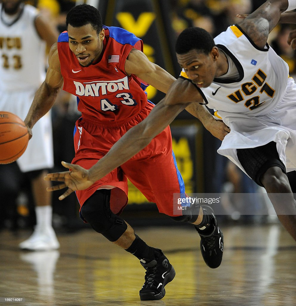 Dayton guard Vee Sanford (43) and Virginia Commonwealth University guard Treveon Graham (21) go after a loose ball in the second half at the Stuart Siegel Center in Richmond, Virginia, Wednesday, January 9, 2013. VCU defeated Dayton, 74-62.