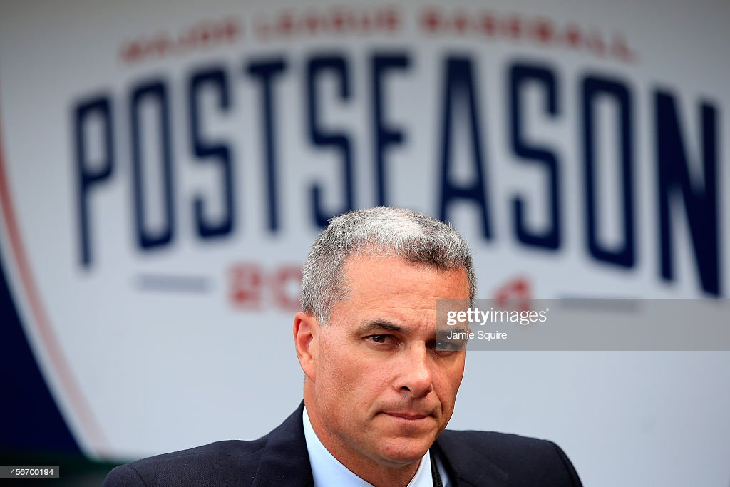 Dayton Moore, general manager of the Kansas City Royals looks on prior to Game Three of the American League Division Series against the Los Angeles Angels at Kauffman Stadium on October 5, 2014 in Kansas City, Missouri.