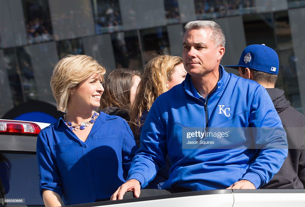 Dayton Moore, GM of the Kansas City Royals, waves to fans along the parade route in fron of Sprint Center on November 3, 2015 in Kansas City, Missouri.
