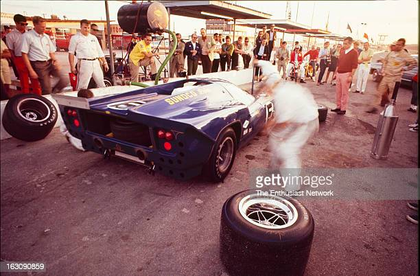 Daytona 24 Hour Race Co drivers Mark Donohue and Chuck Parsons of Penske Racing come in to the pits in their Chevrolet powered Lola T70 Mk3 GT The...