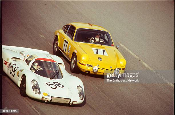 Daytona 24 Hour Race Codrivers Alex SolerRoig and Rudi Lins drive a Porsche 907 on the outside of Marty Gifford and Bill Campbell of Williams Racing...