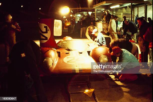Daytona 24 Hour Race Crews work on the Ferrari 312P of Sam Posey and Mike Parkes in the pits during a night stint The two will go on to finish the...