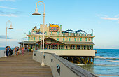 Daytona Beach Florida famous Main Street Pier and Boardwalk pier with restaurant Joes Crab Shack on water for tourists with boardwalk at World's Most...