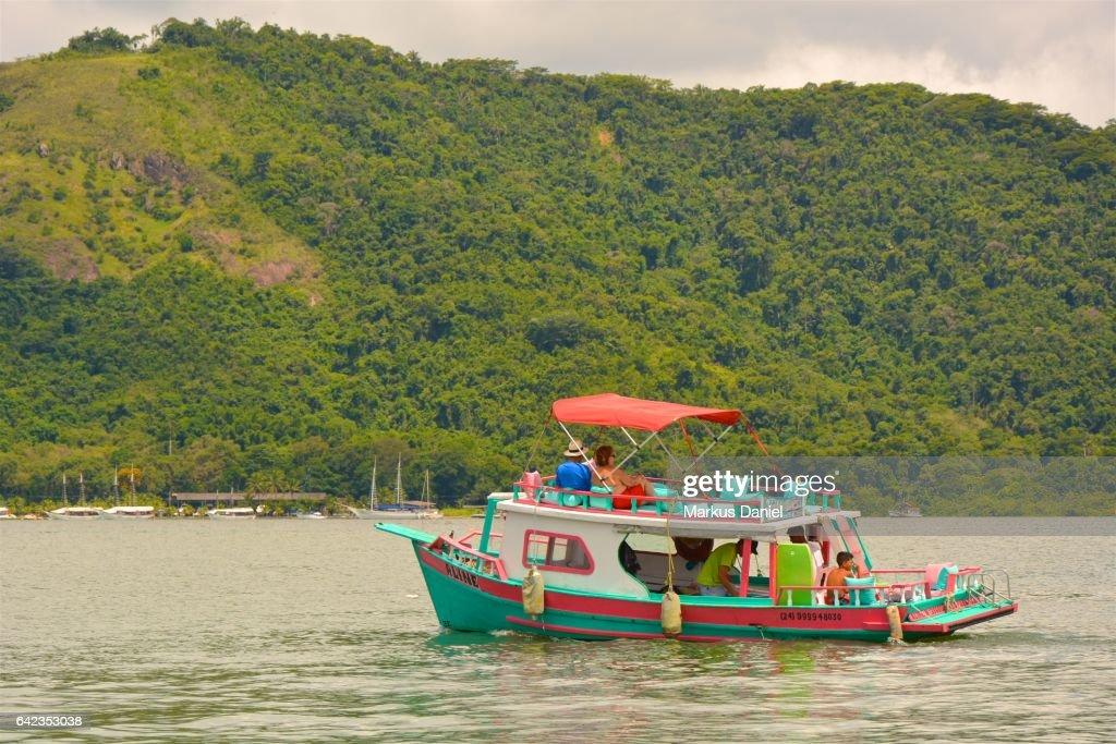 Day-trip tourist boat in the bay of Paraty, Rio de Janeiro : Stock Photo