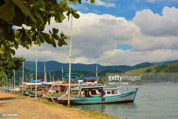Day-trip tourist boats at the main pier in the town of Paraty, Rio de Janeiro