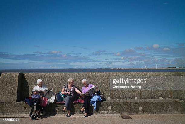 Daytrippers and children on the Summer break from school enjoy the warm weather at New Brighton beach on August 11 2015 in New Brighton England The...