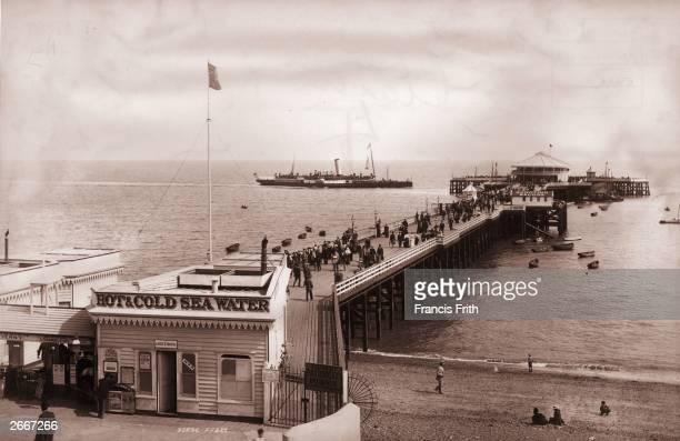 Daytrippers on the pier at the seaside resort town of ClactononSea in Essex