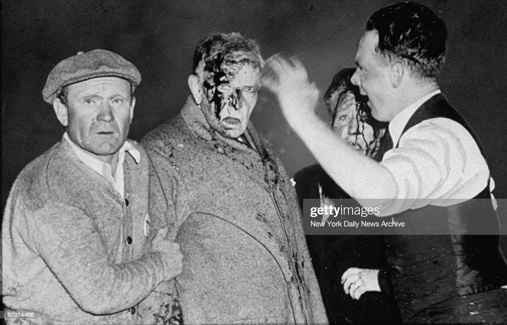 Dazed and bloodied by the shattering explosion that wrecked the Hindenburg, this man and woman passeger are treated at the scene.