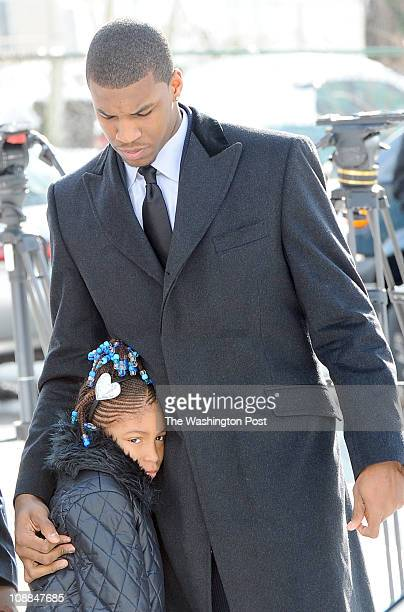 Universirty of Kansas forward Thomas Robinson comforts his little sister Jayla as they arrive for the funeral for their mother Lisa Robinson on...