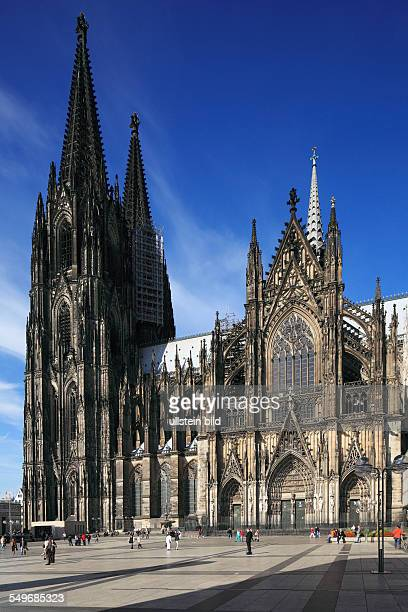 DCologne land North Westphalia NRW Cologne Cathedral Hohe Domkirche Saint Peter and Maria catholic church gothic church towers Roncalli square view...