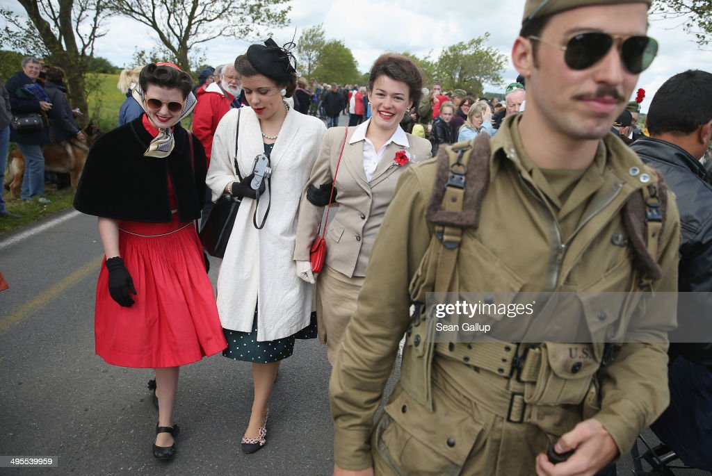 D-Day re-enactment enthusiasts and siblings Faith, Liberty, Jubilee and Joshua Phillips from San Antonio, Texas, attend a planned parachute drop on June 4, 2014 at Carentan, France. Friday the 6th of June is the 70th anniversary of the D-Day landings that saw 156,000 troops from the Allied countries, including the United Kingdom and the United States, join forces to launch an audacious attack on the beaches of Normandy, these assaults are credited with the eventual defeat of Nazi Germany. A series of events commemorating the 70th anniversary are planned for the week with many heads of state travelling to the famous beaches to pay their respects to those who lost their lives.