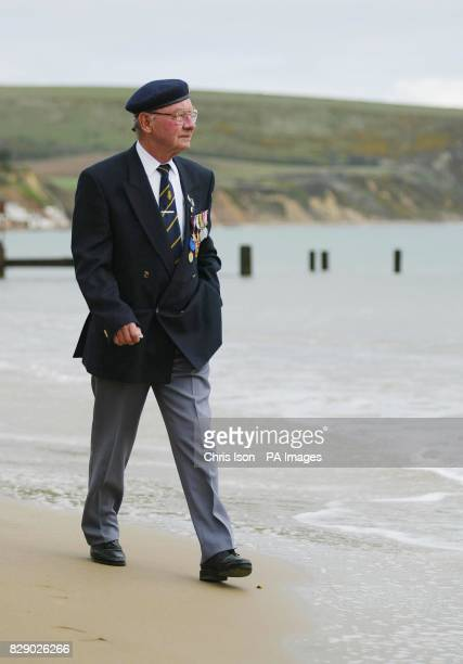DDay veteran Clifford Brown from Swanage in Dorset who survived the assault on Omaha Beach in Normandy by digging a hole in the sand Mr Brown was...