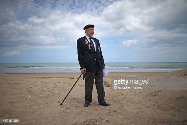 Day veteran George French aged 89 of The Kings Royal Rifles and from Swindon poses on sword Beach after the Royal Artillery Commemoration Parade and...