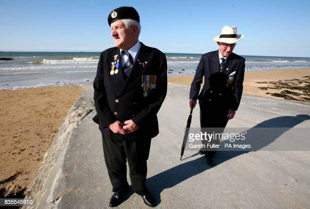 DDay veteran George Taylor a Sapper in the Royal Engineers during World War Two with Percy Lewis of the 1st Buckinghamshire Battalion walk along the...