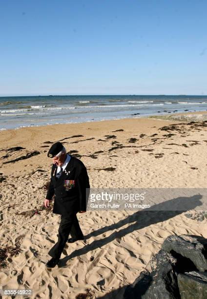DDay veteran George Taylor a Sapper in the Royal Engineers during World War Two walks along the beach in Arromanches France ahead of the 65th...