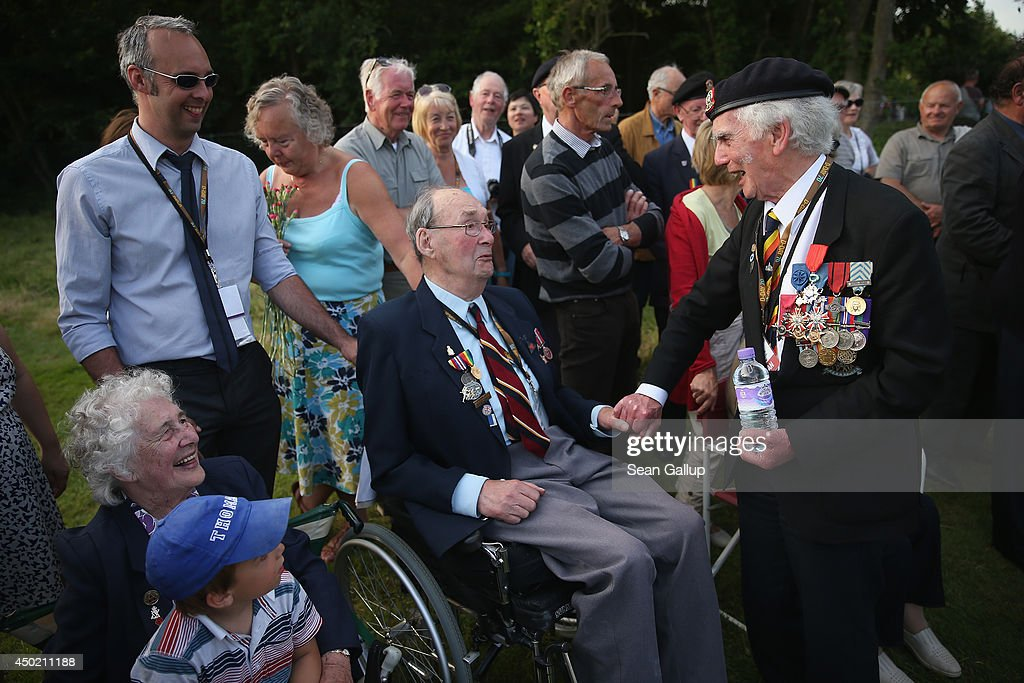 D-Day veteran Ian Forsythe (R), who served in the Royal British Legion Scotland and landed in the invasion at Gold Beach, chats with fellow veteran Lionel Roebuck, 90, who served in the Second East Yorks Regiment and landed at Sword Beach, at a ceremony at the British Cemetery on June 6, 2014 at Hermanville, France. Friday the 6th of June is the 70th anniversary of the D-Day landings that saw 156,000 troops from the Allied countries, including the United Kingdom and the United States, join forces to launch an audacious attack on the beaches of Normandy, these assaults are credited with the eventual defeat of Nazi Germany. A series of events commemorating the 70th anniversary are planned for the week with many heads of state travelling to the famous beaches to pay their respects to those who lost their lives.