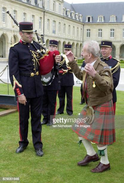 DDay veterans Royal Signalman William Young from Glasgow dances a jig for a French piper at a ceremony in Caen to award Normandy 60th anniversary...