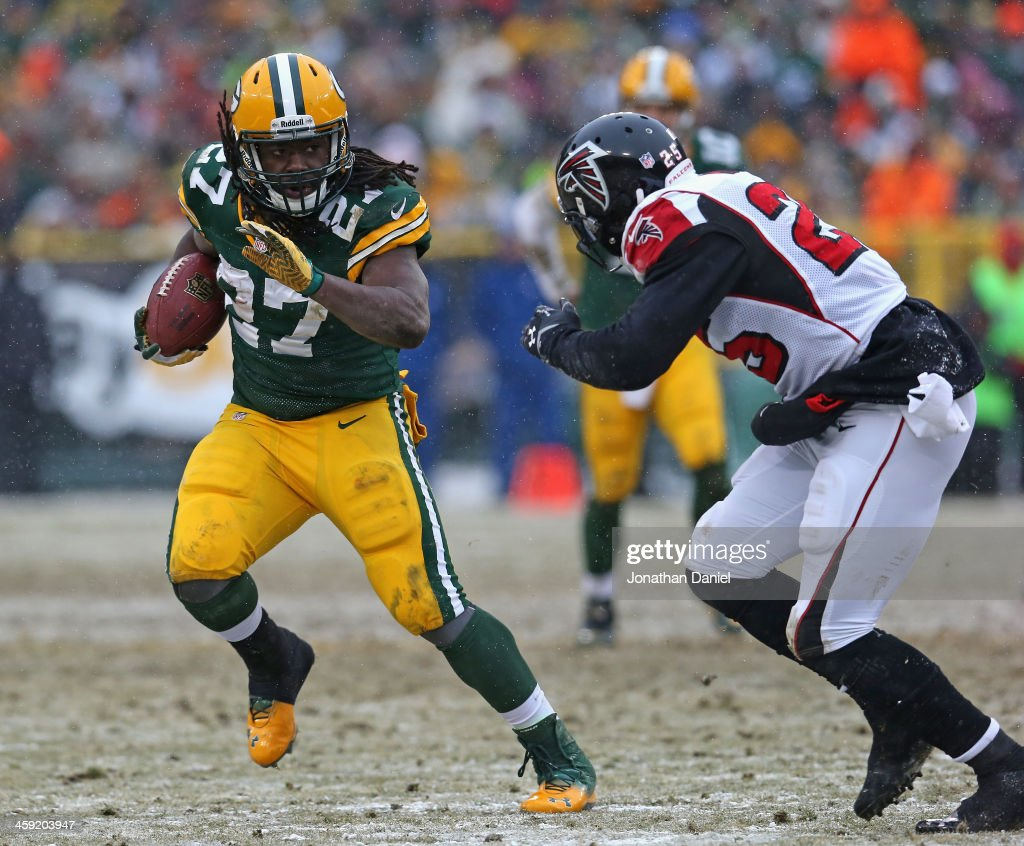 ddie Lacy #27 of the Green Bay Packers avoids William Moore #25 of the Atlanta Falcons at Lambeau Field on December 8, 2013 in Green Bay, Wisconsin. The Packers defeated the Falcons 22-21.