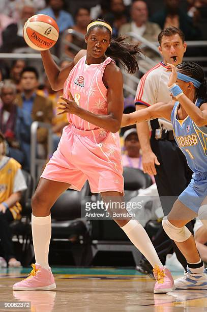 De Lisha MiltonJones of the Los Angeles Sparks handles the ball against Tamera Young of the Chicago Sky on August 25 2009 at Staples Center in Los...