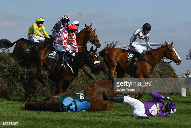 De Luain Gorm ridden by GGallagher falls at the Chair jump in The John Smith�s Fox Hunters Steeple Chase run during day one of the John Smith's Grand...