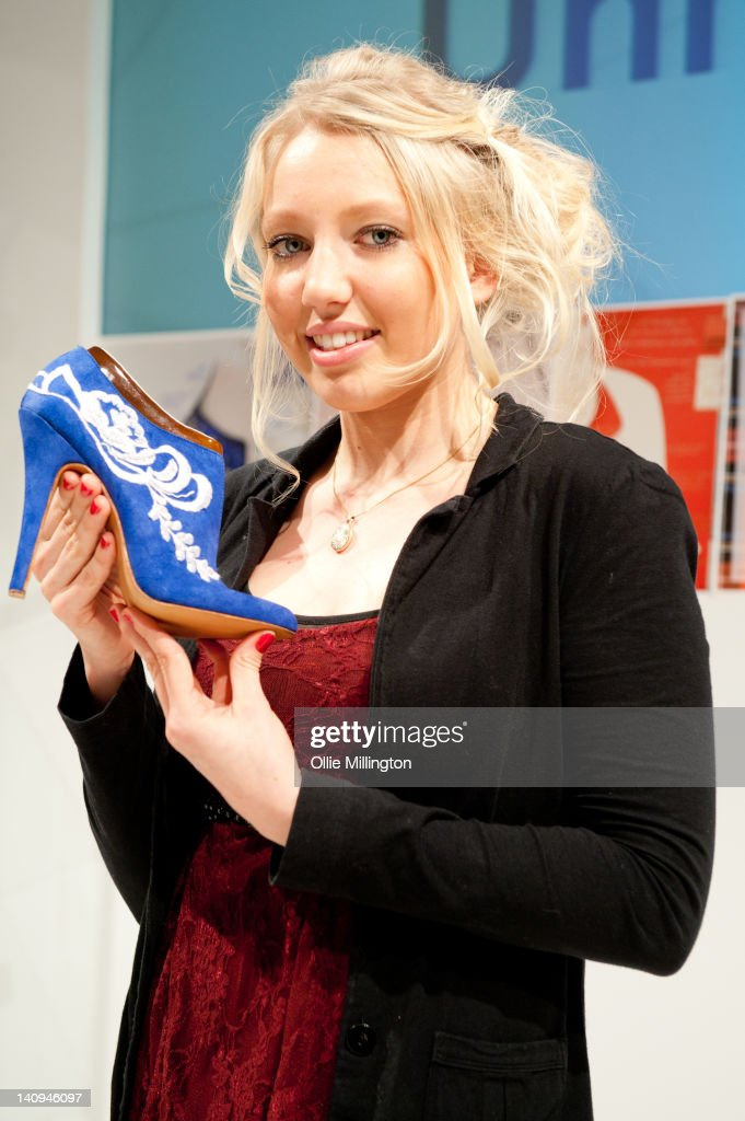De Montfort University footwear student Becka Hunt shows the design that Catherine, Duchess of Cambridge picked from a selection of others to be made into a shoe for her during their visit to Leicester on the first date of Queen Elizabeth II's Diamond Jubilee tour of the UK on March 8, 2012 in Leicester, England.