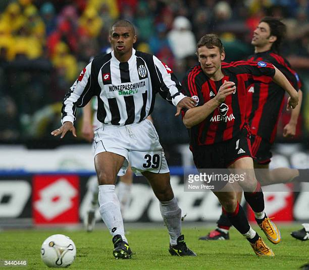 De Souza Juarez of Siena is pursued by Andriy Schevchenko of Milan during the Serie A match between Siena and AC Milan played at the Artemio Franchi...