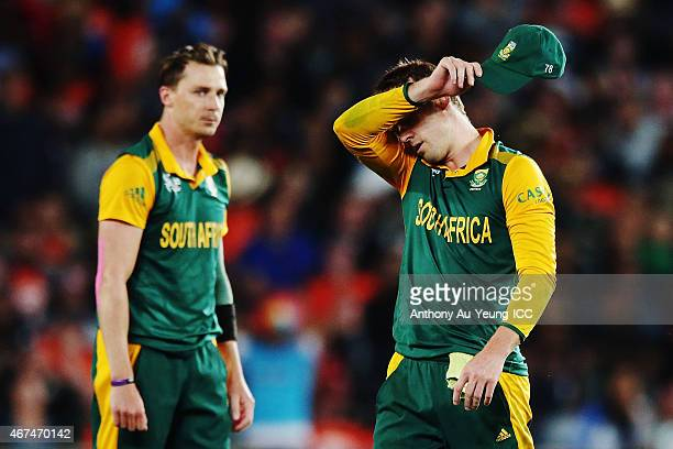 AB de Villiers and Dale Steyn of South Africa react during the 2015 Cricket World Cup Semi Final match between New Zealand and South Africa at Eden...