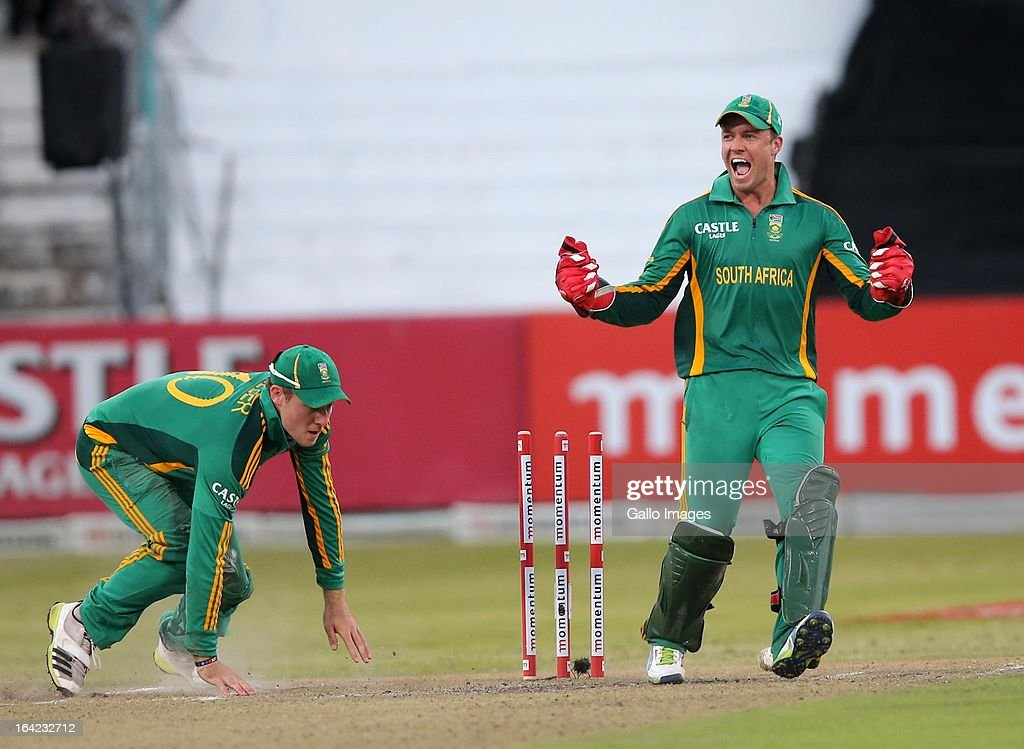 AB de Villiers and David Miller celebrate the run out of Wahab Riaz during the 4th Momentum One Day International match between South Africa and Pakistan at Sahara Stadium Kingsmead on March 21, 2013 in Durban, South Africa.