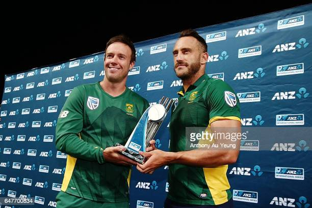 AB de Villiers and Faf du Plessis of South Africa pose with the ODI series trophy after winning game five of the One Day International series between...