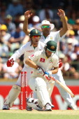 AB de Villiers and Jacques Kallis of South Africa celebrate the wicket of Matthew Wade of Australia during day two of the Third Test Match between...