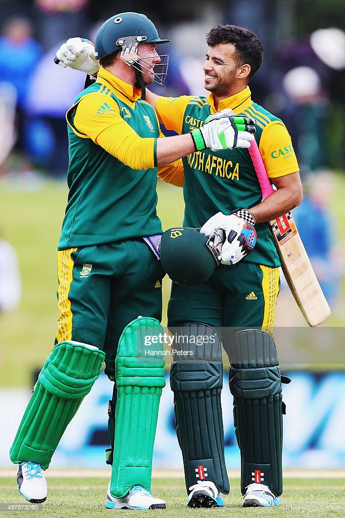 AB de Villiers and Jean-Paul Duminy of South Africa celebrate after winning the One Day International match between New Zealand and South Africa at Bay Oval on October 21, 2014 in Mount Maunganui, New Zealand.