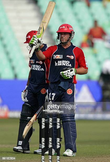 AB de Villiers celebrates his century during the IPL T20 match between Chennai Super Kings and Delhi Daredevils from Sahara Park on April 23 2009 in...